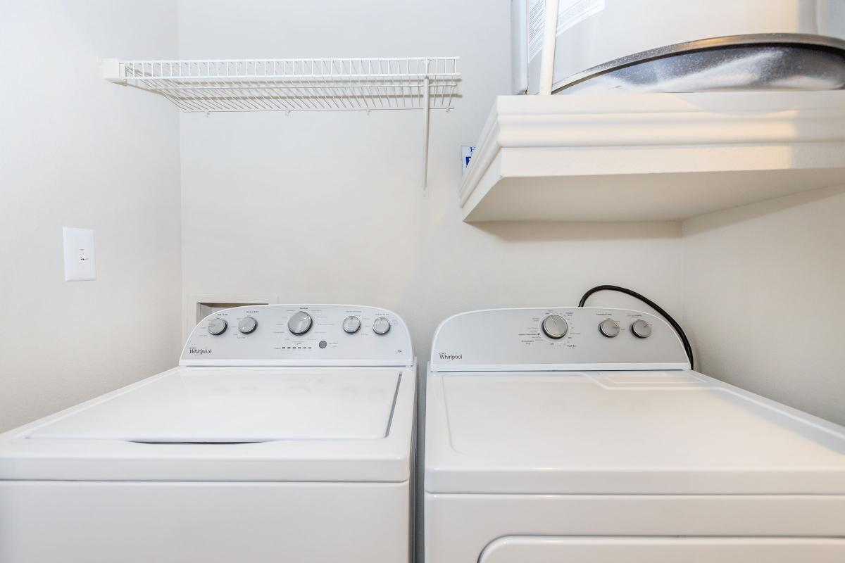 a white sink sitting under a microwave