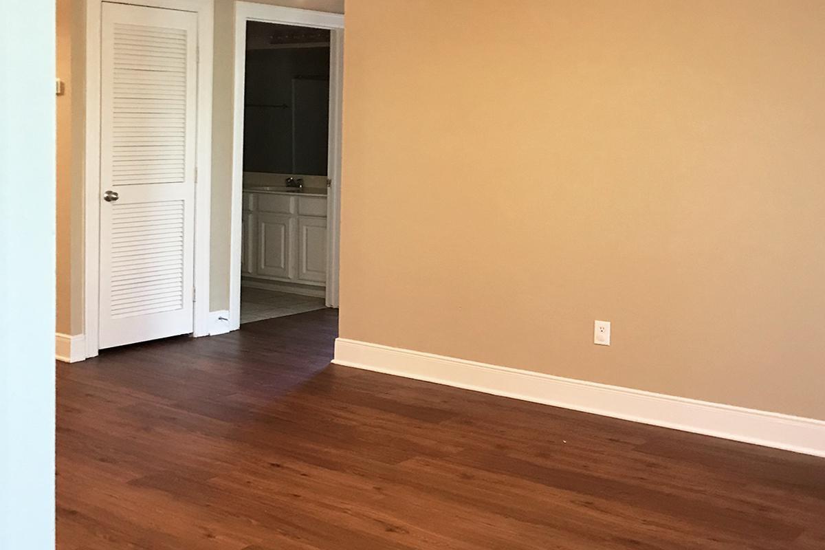 a close up of a hard wood floor next to a door