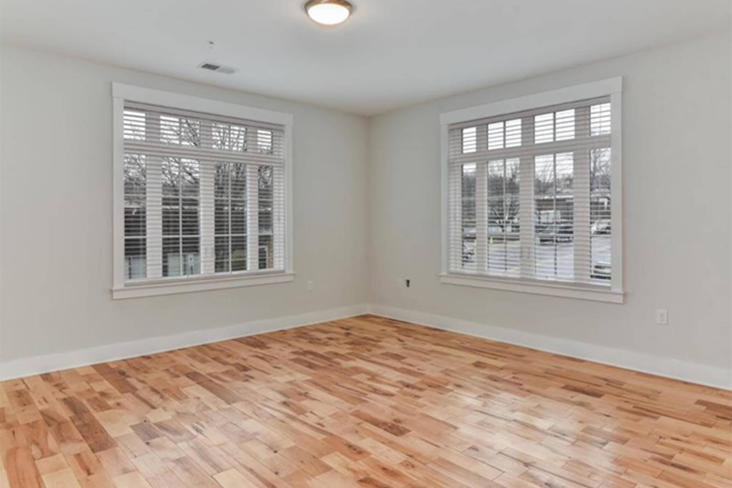 a close up of a hard wood floor next to a window