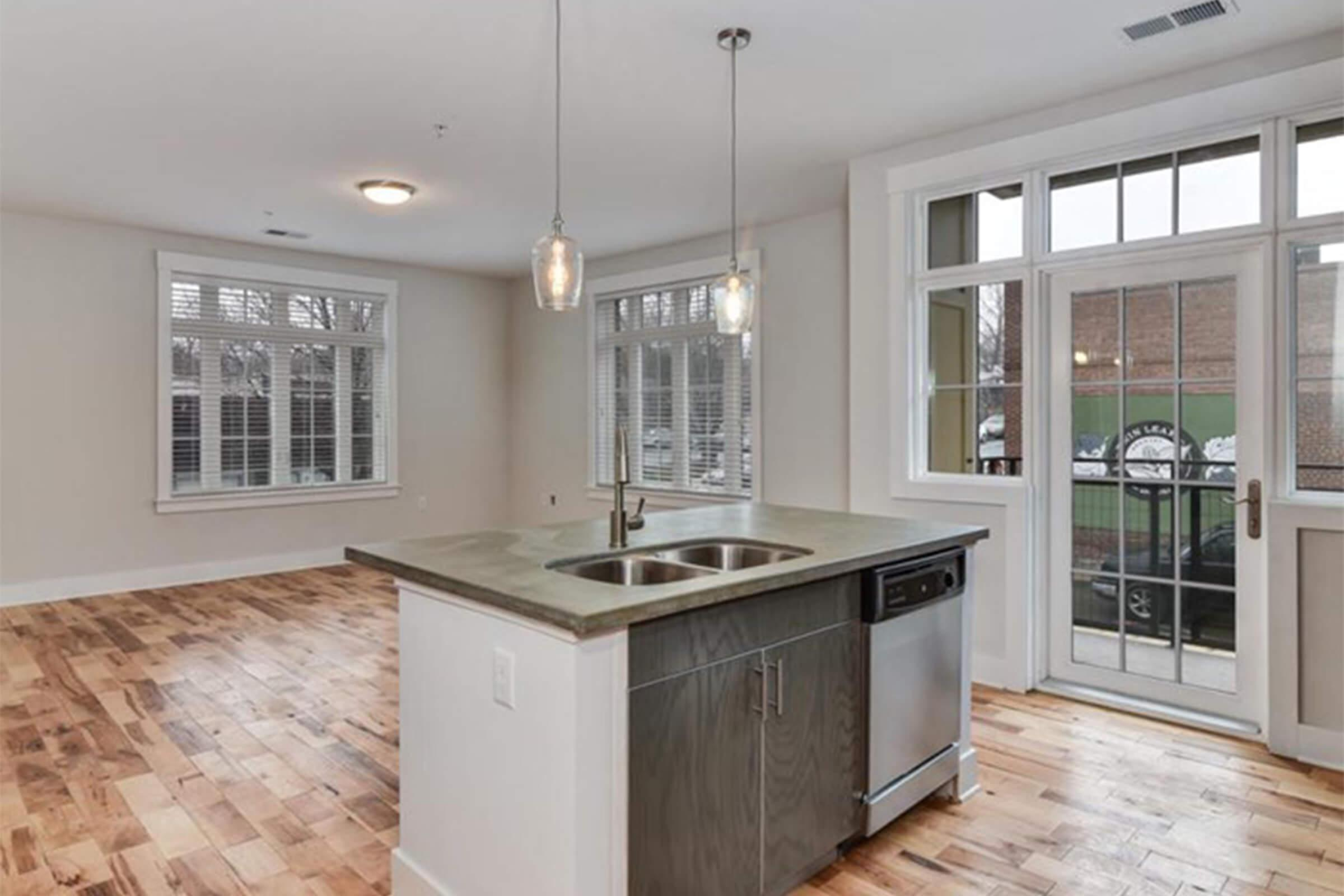 a kitchen with a large window