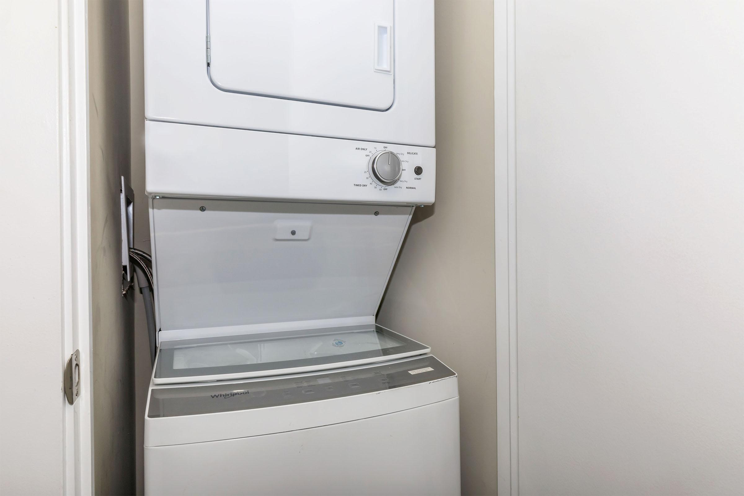 a white refrigerator freezer sitting next to a door