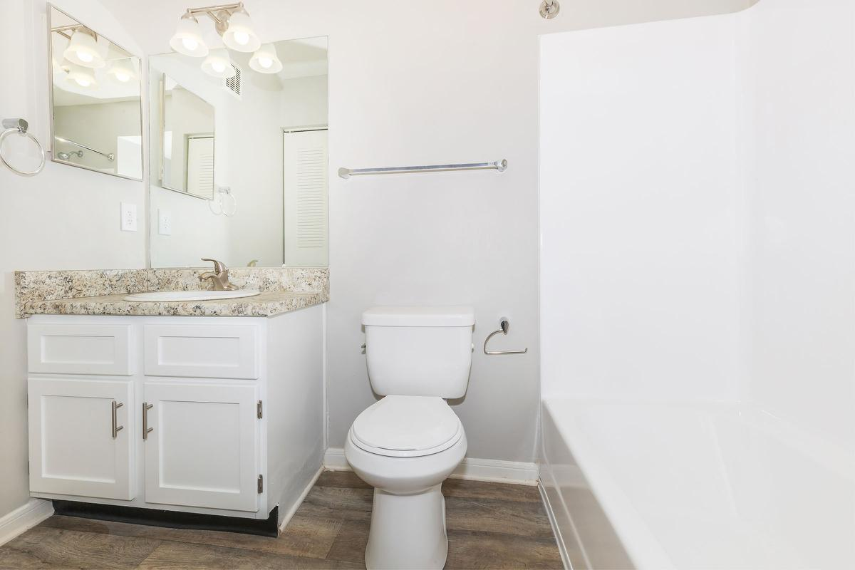 a white sink sitting next to a door