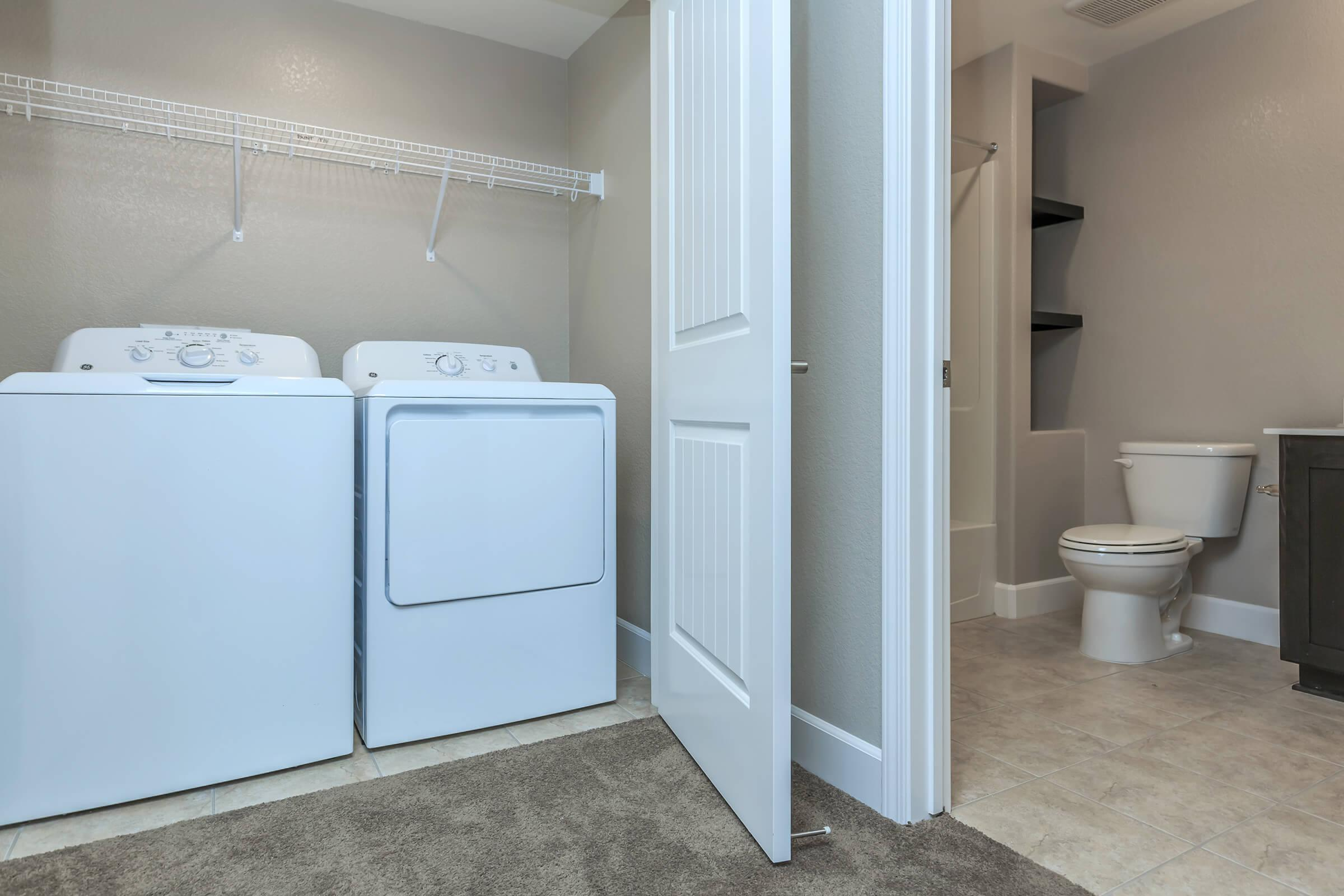 a room with a sink and a refrigerator