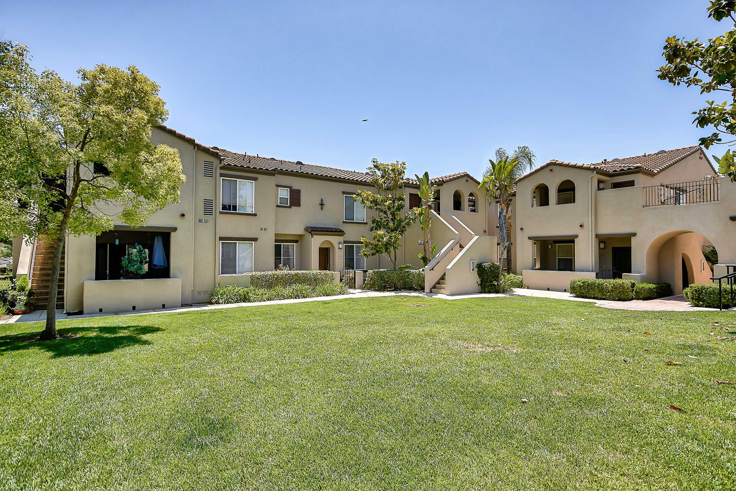 Laurel Canyon Apartment Homes community building with a green grass