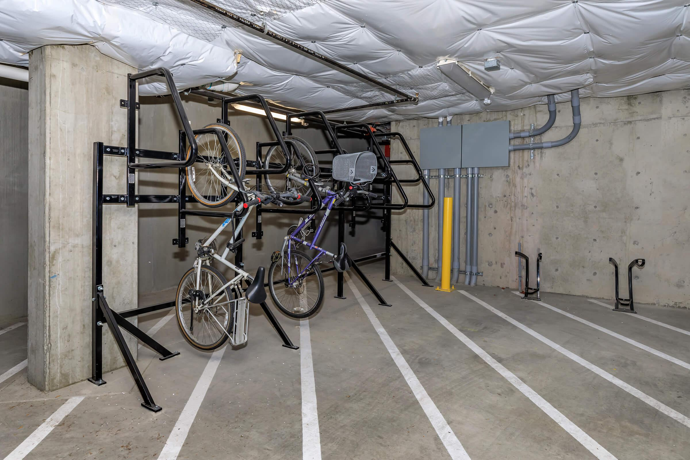 a bicycle parked on the side of a building