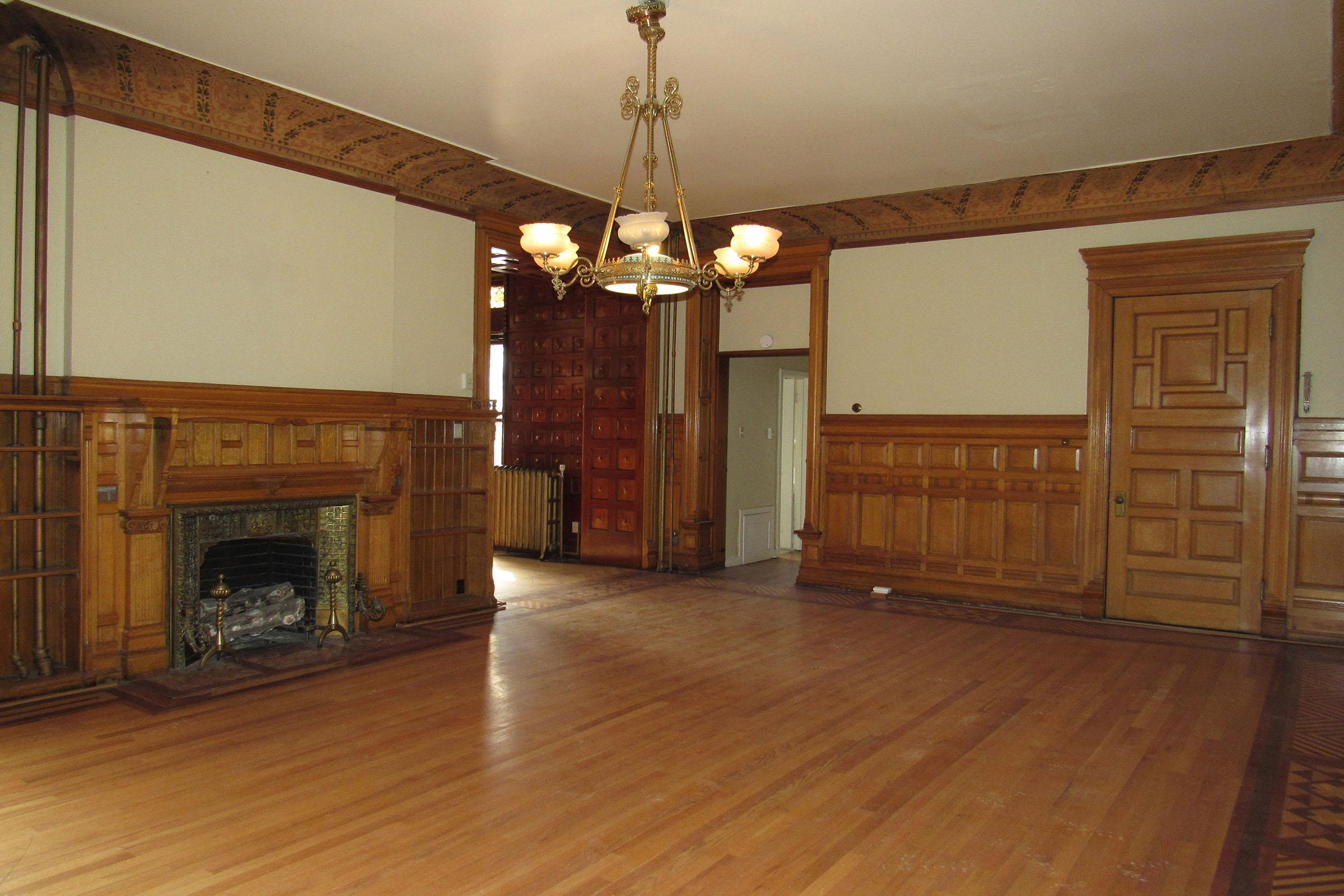 a living room filled with furniture on top of a hard wood floor