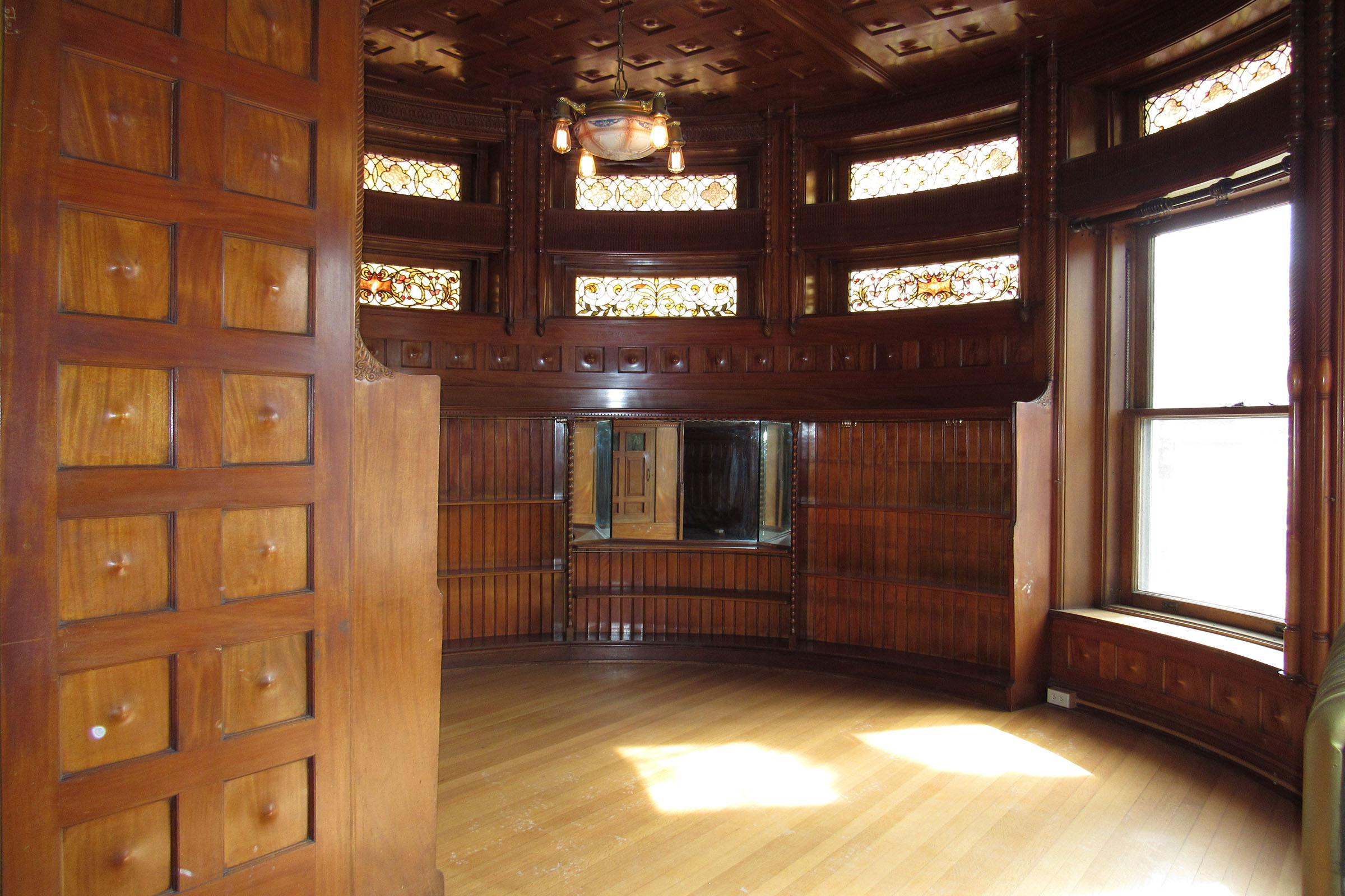 a large wooden cabinet next to a window