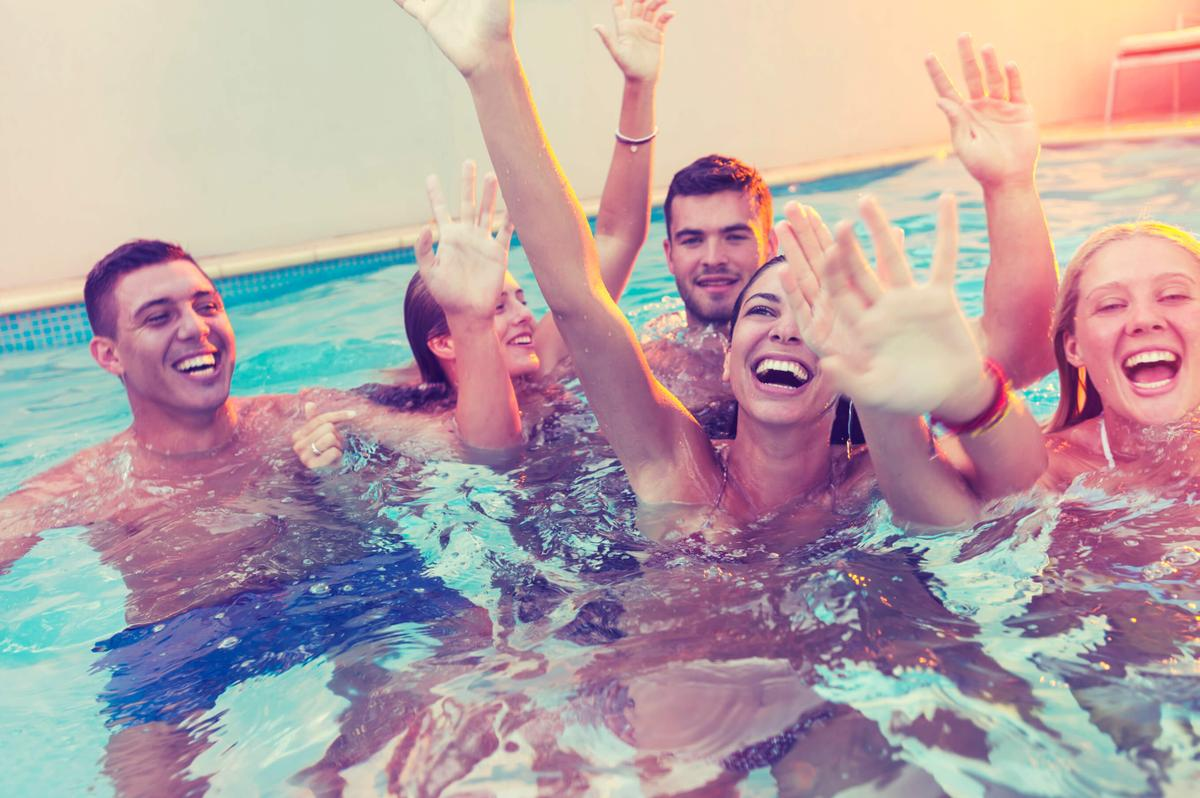 a group of people in a swimming pool