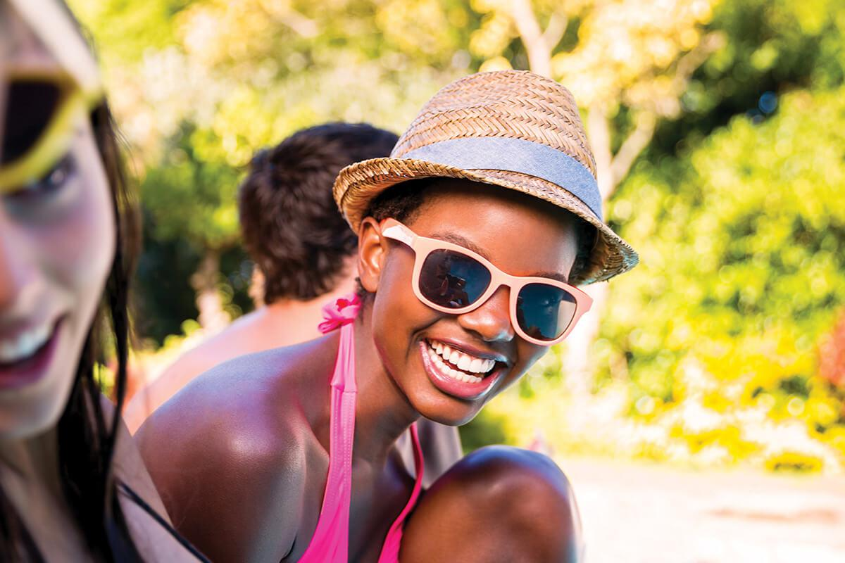 a woman wearing sunglasses posing for the camera