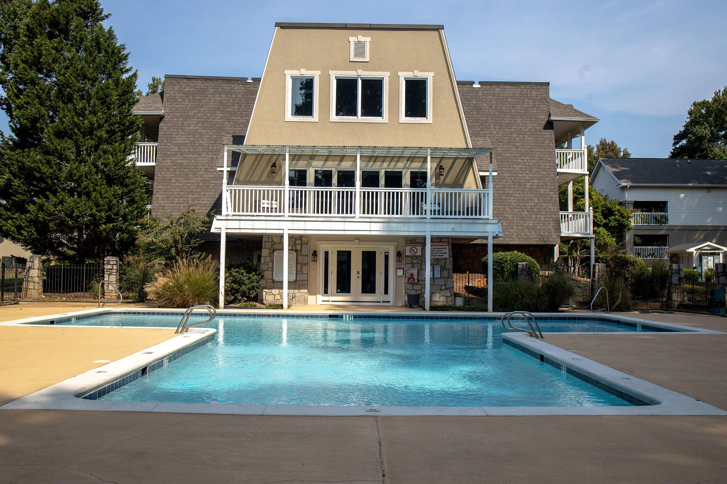 a large pool of water in front of a house