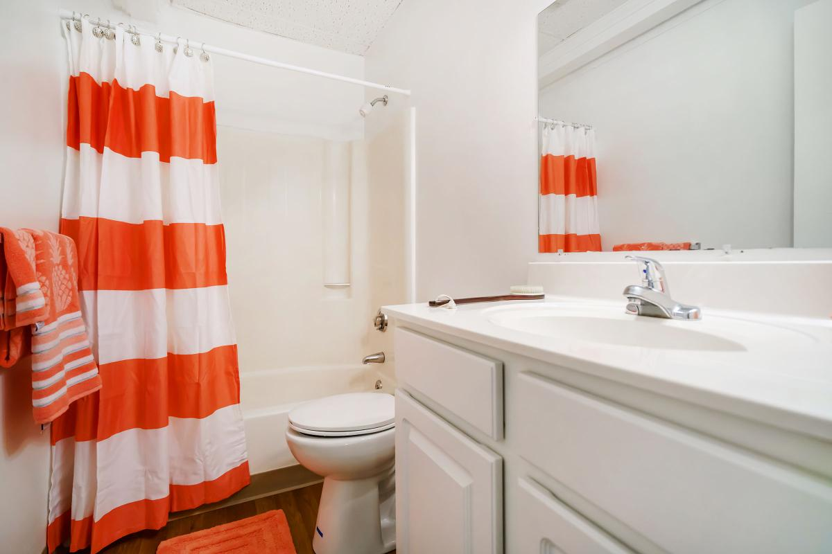 an orange and white shower curtain