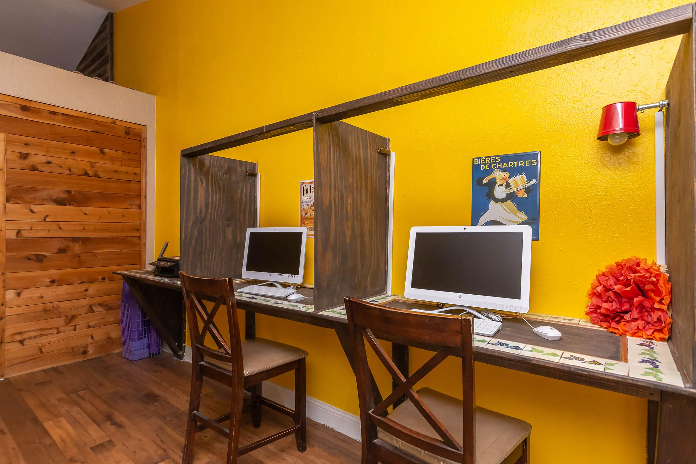 a dining room table in front of a computer