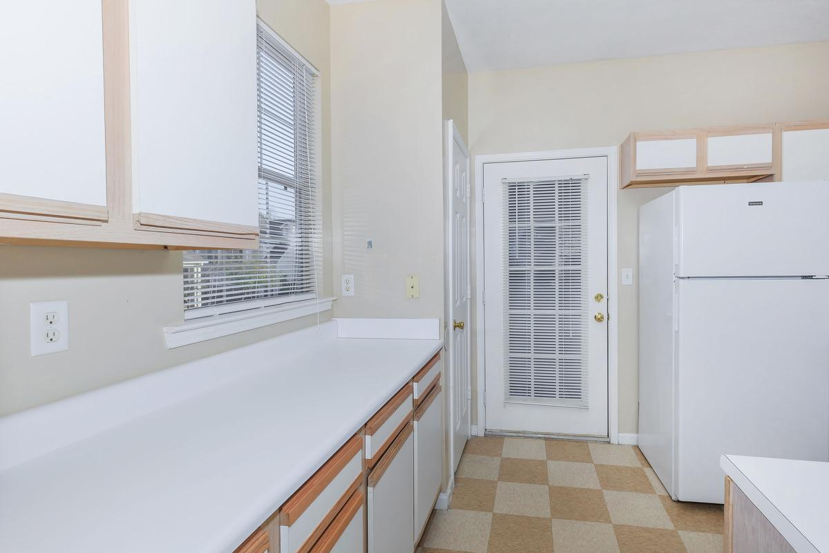 a kitchen with a white tub sitting next to a window