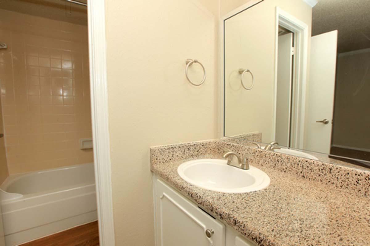 a glass shower door next to a sink