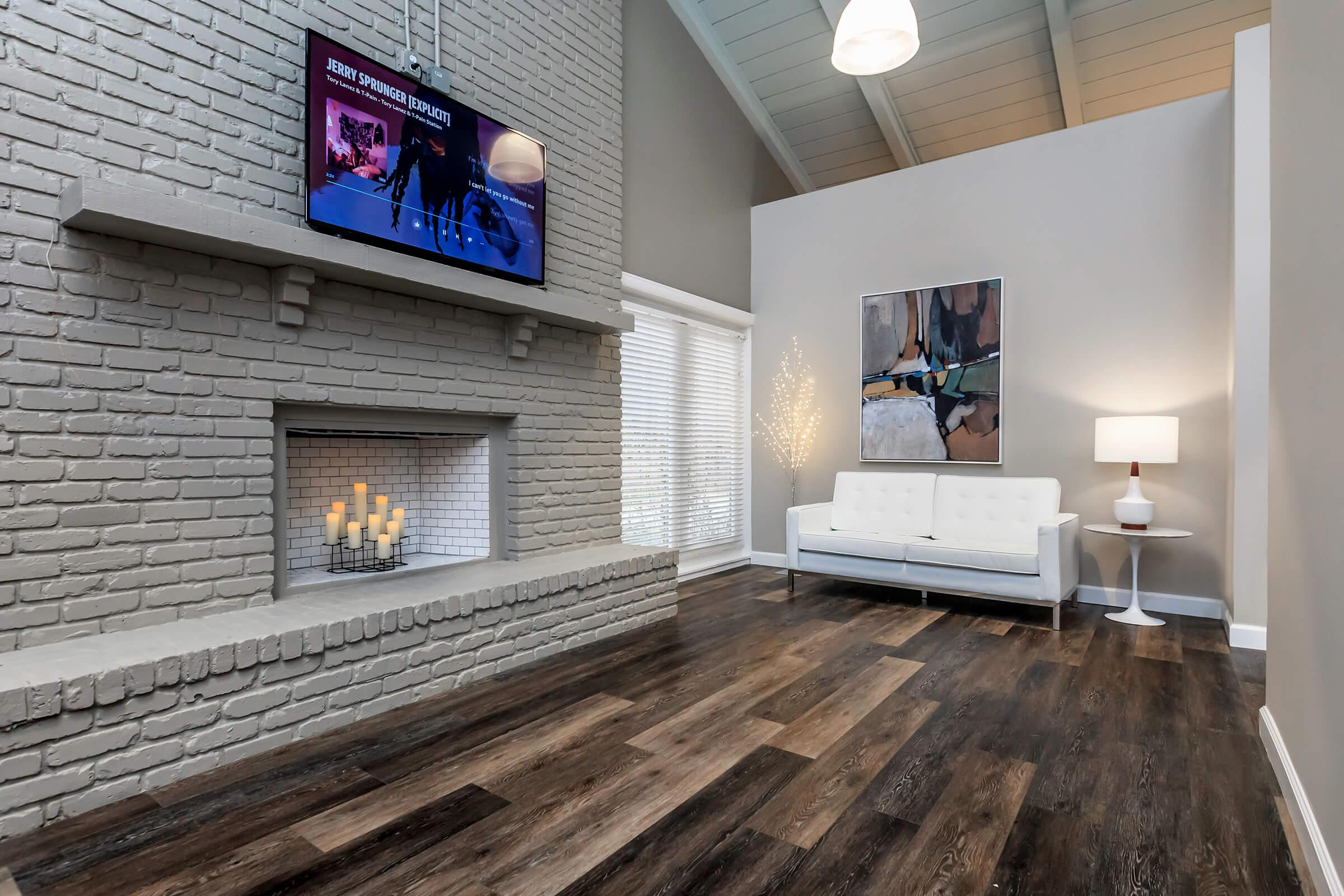 a living room with a fireplace
