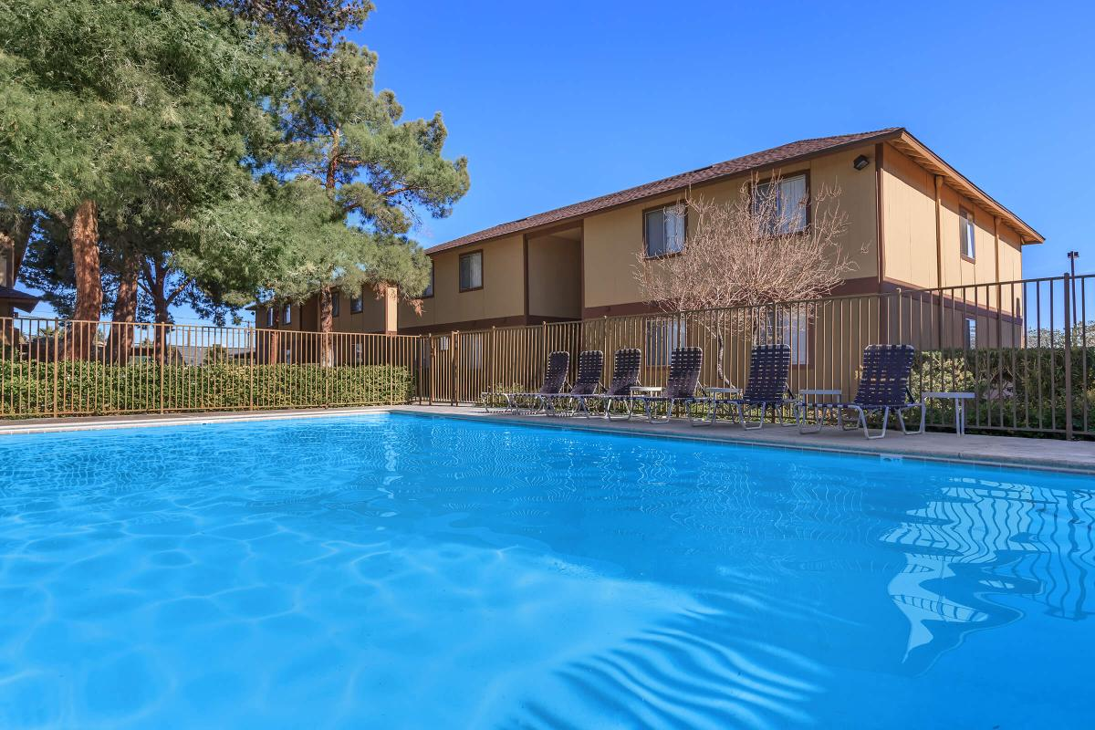 ENJOY THOSE HOT SUMMER DAYS AT ALPINE VILLAGE IN OUR SHIMMERING SWIMMING POOL