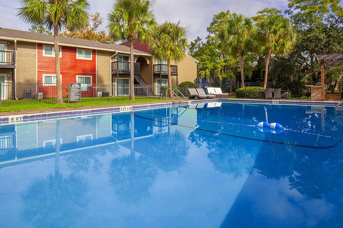 Enjoy our shimmering swimming pool here at Heron Walk Apartments in Jacksonville, Florida