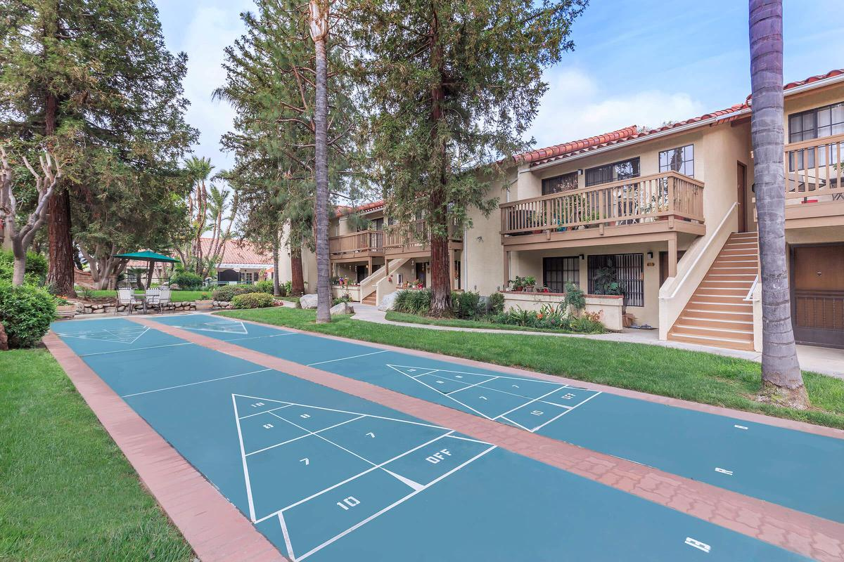 a basketball court in front of a building