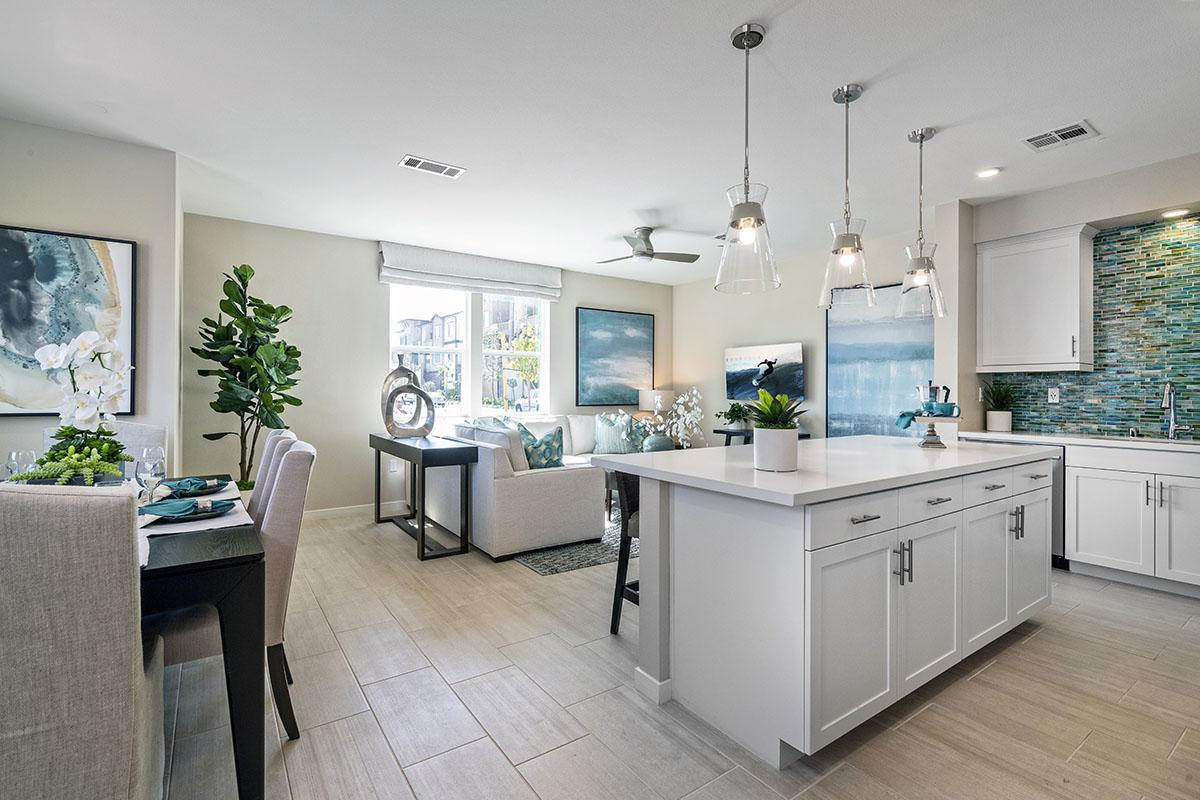 a kitchen with a lot of furniture in a room