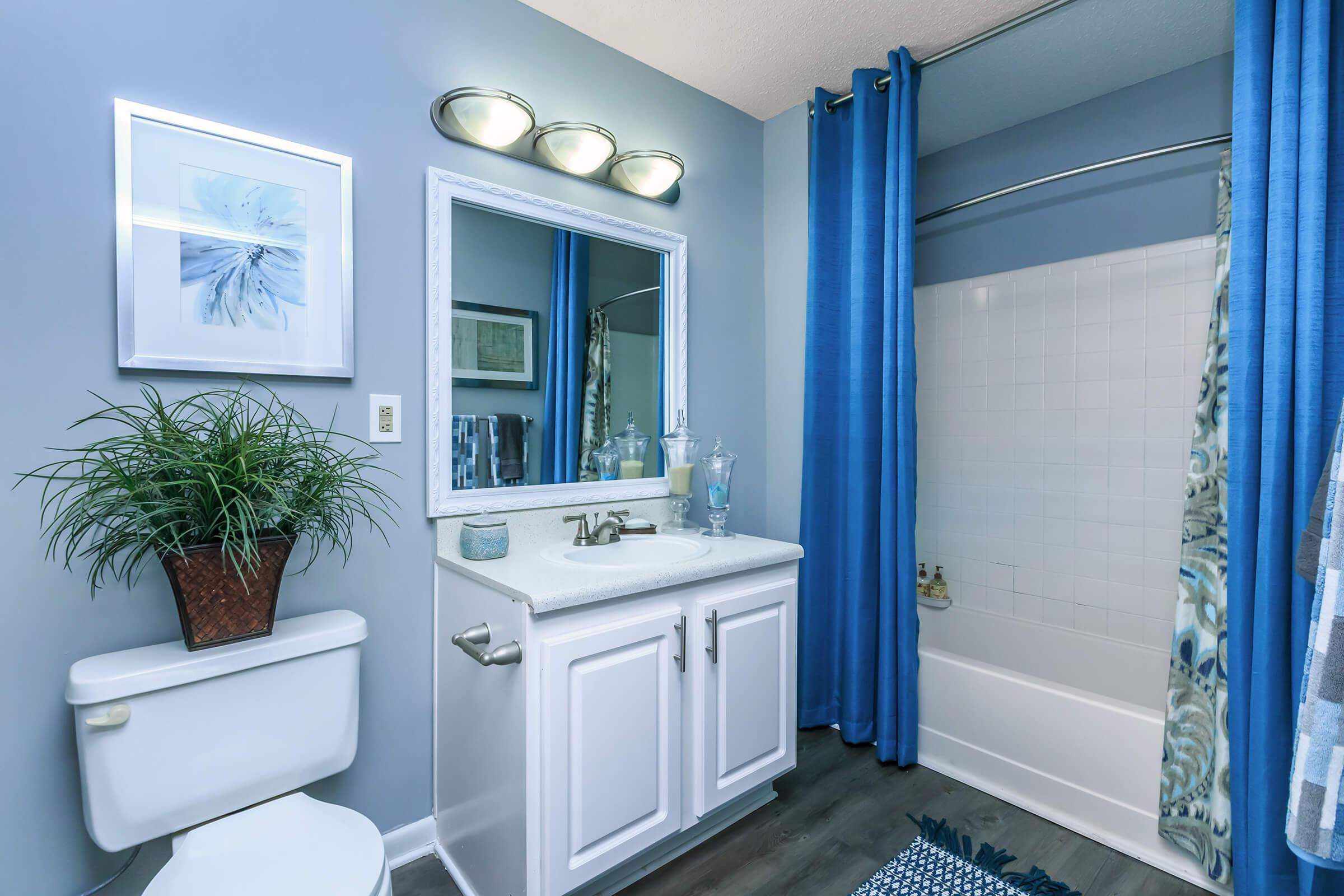 a blue and white tub next to a window