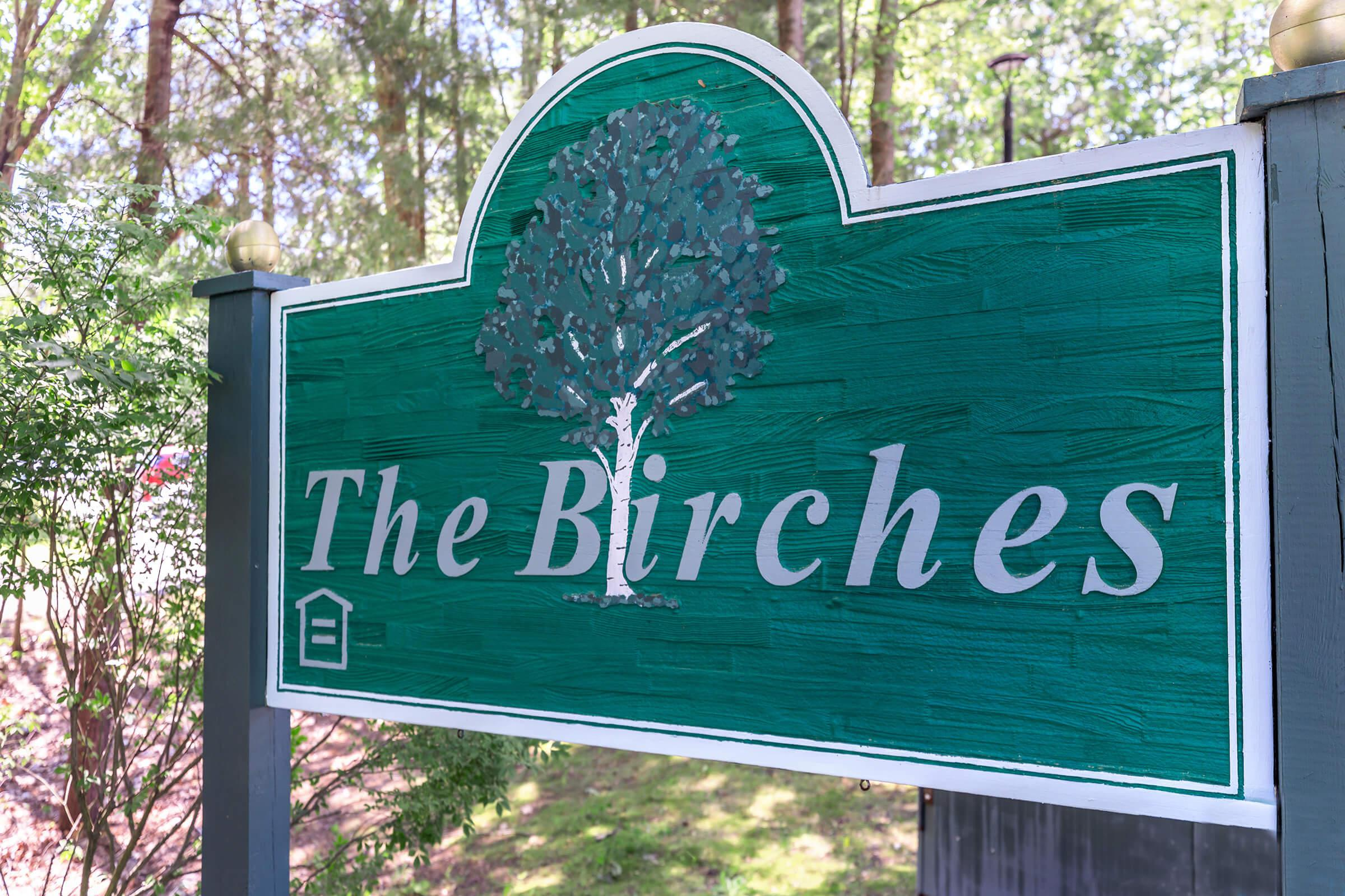 a green sign with white text