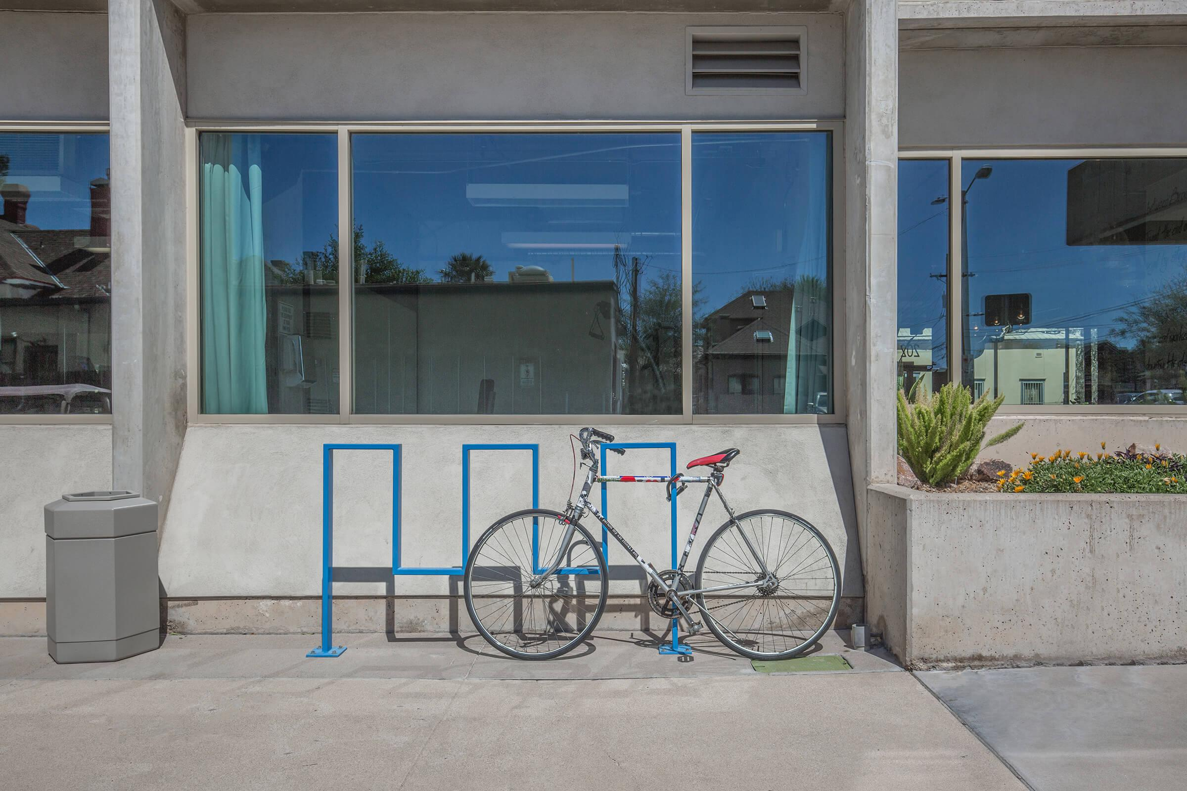 a bicycle parked in front of a building