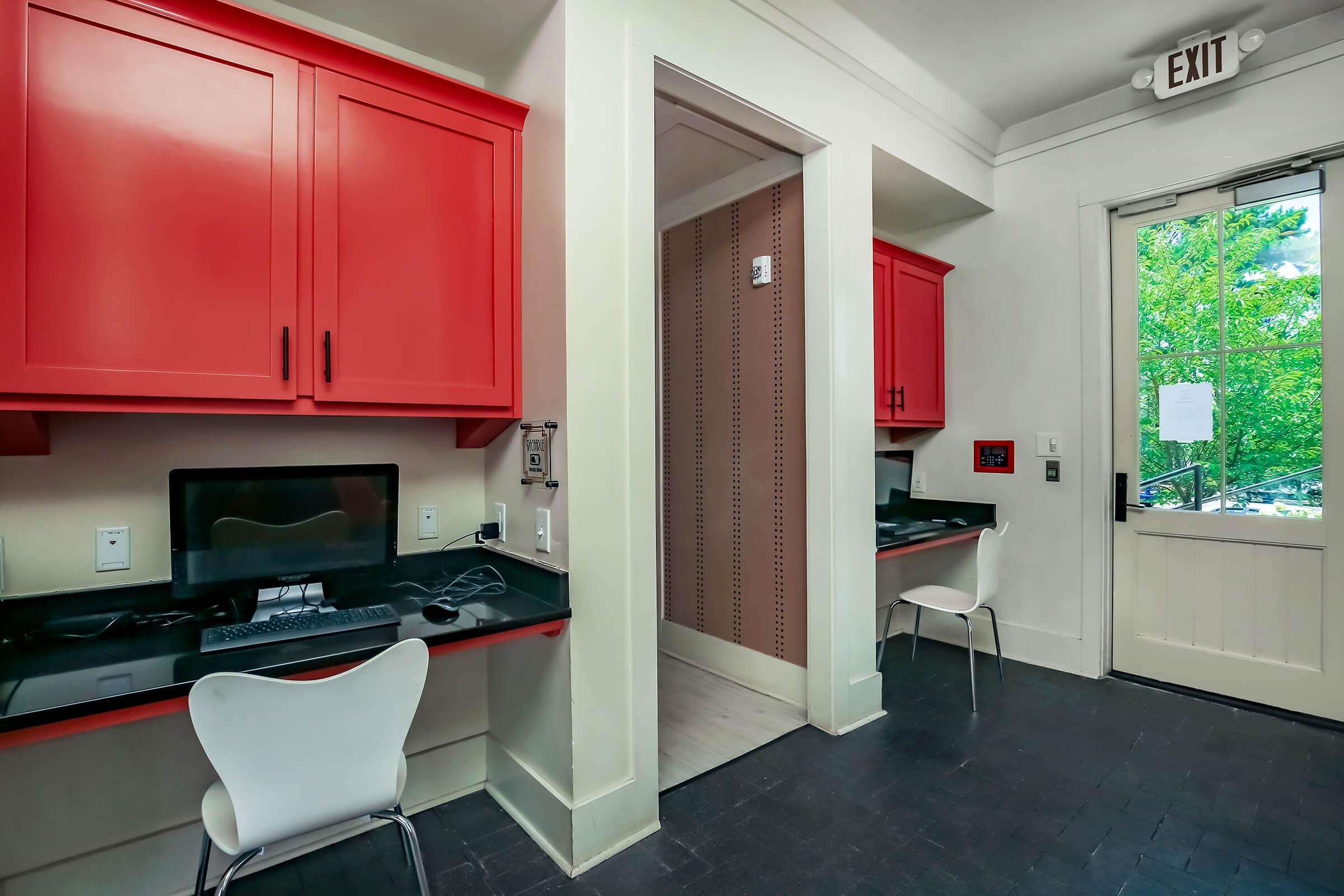 a kitchen with a red door