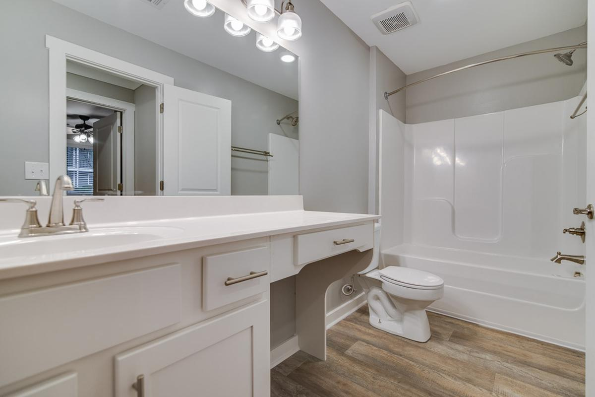 a large white tub sitting next to a sink