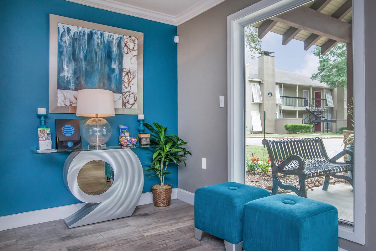 a living room with a blue chair