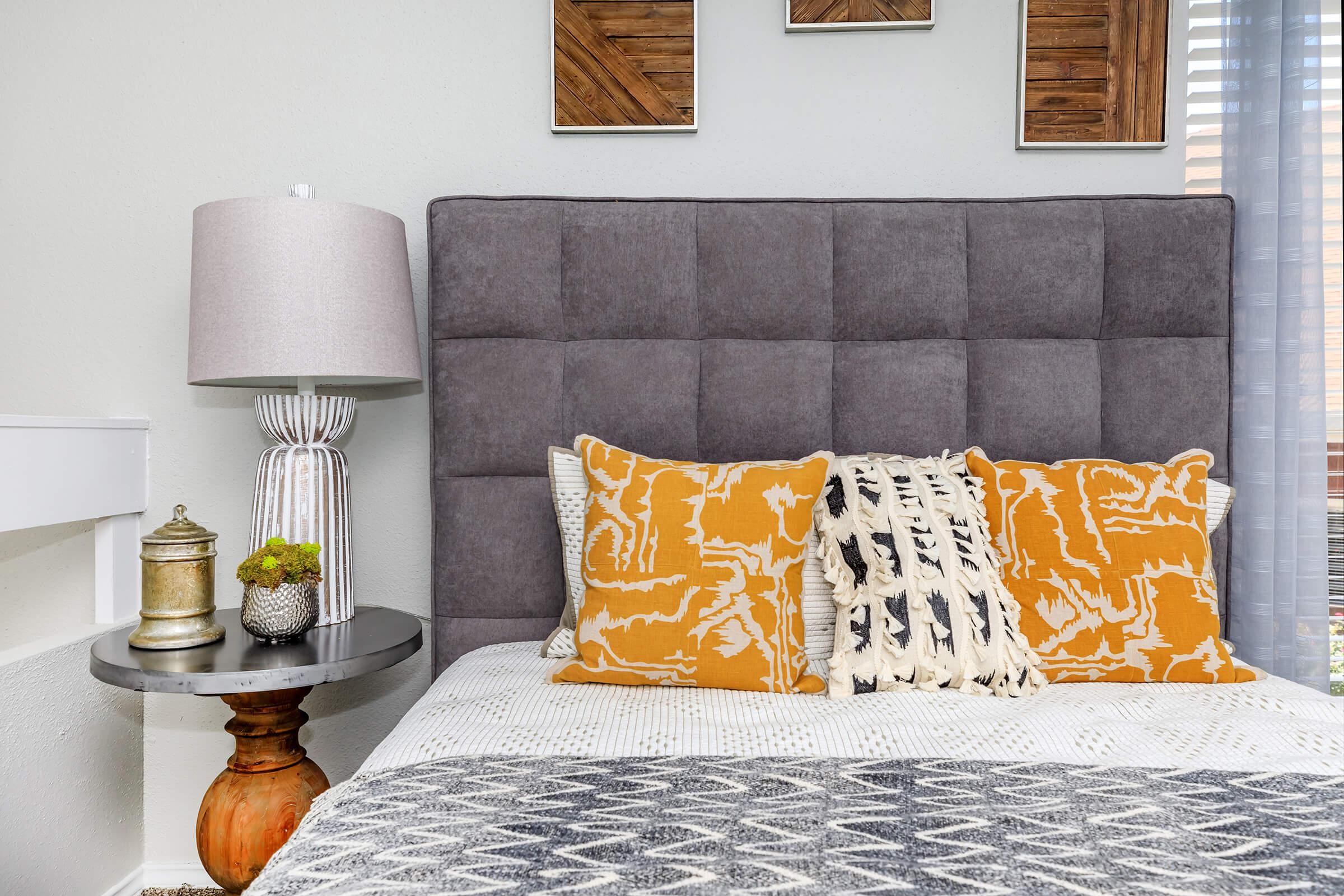 a bedroom with a glass of orange juice