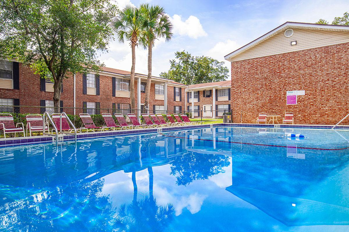 a large brick building with a pool