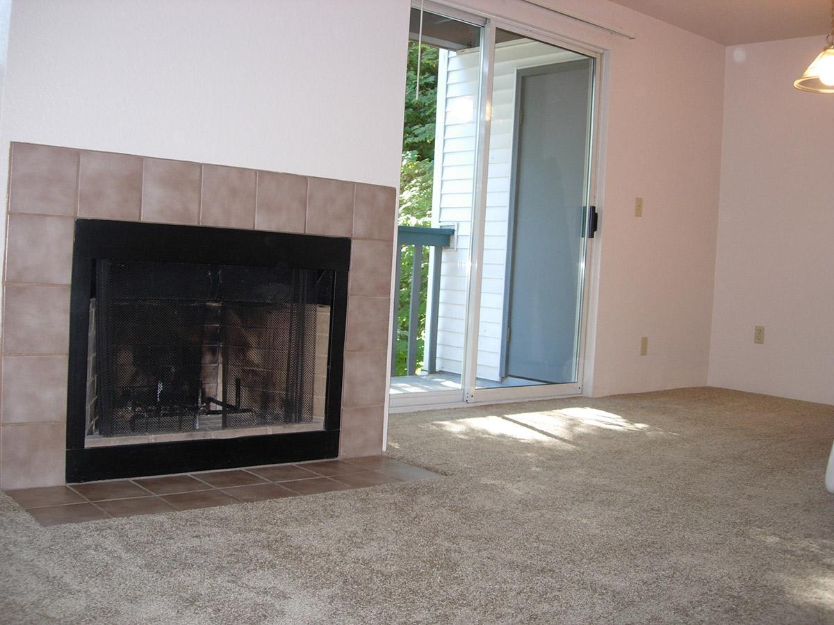 a fire place sitting in a living room with a fireplace
