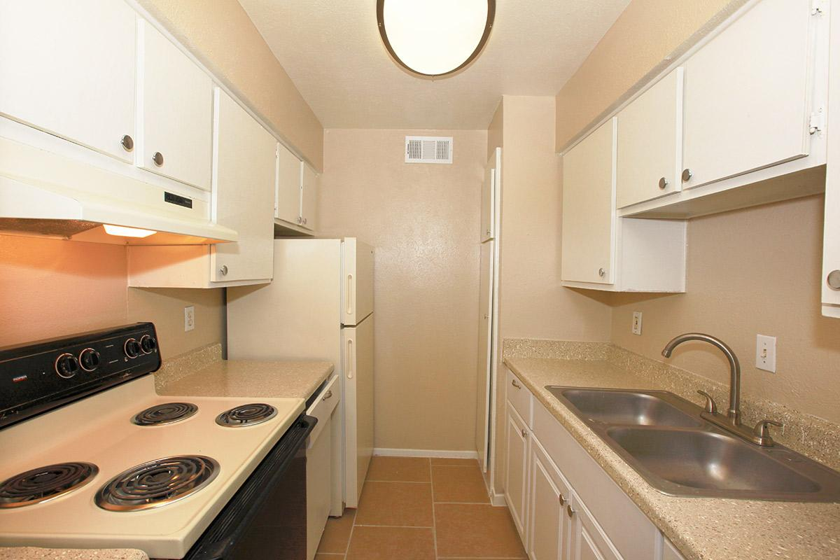 a kitchen with a stove top oven sitting next to a sink