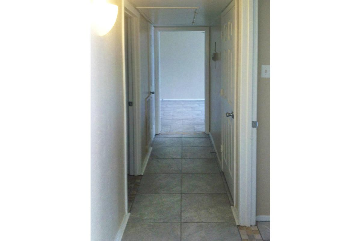 a view of a tiled floor next to a door