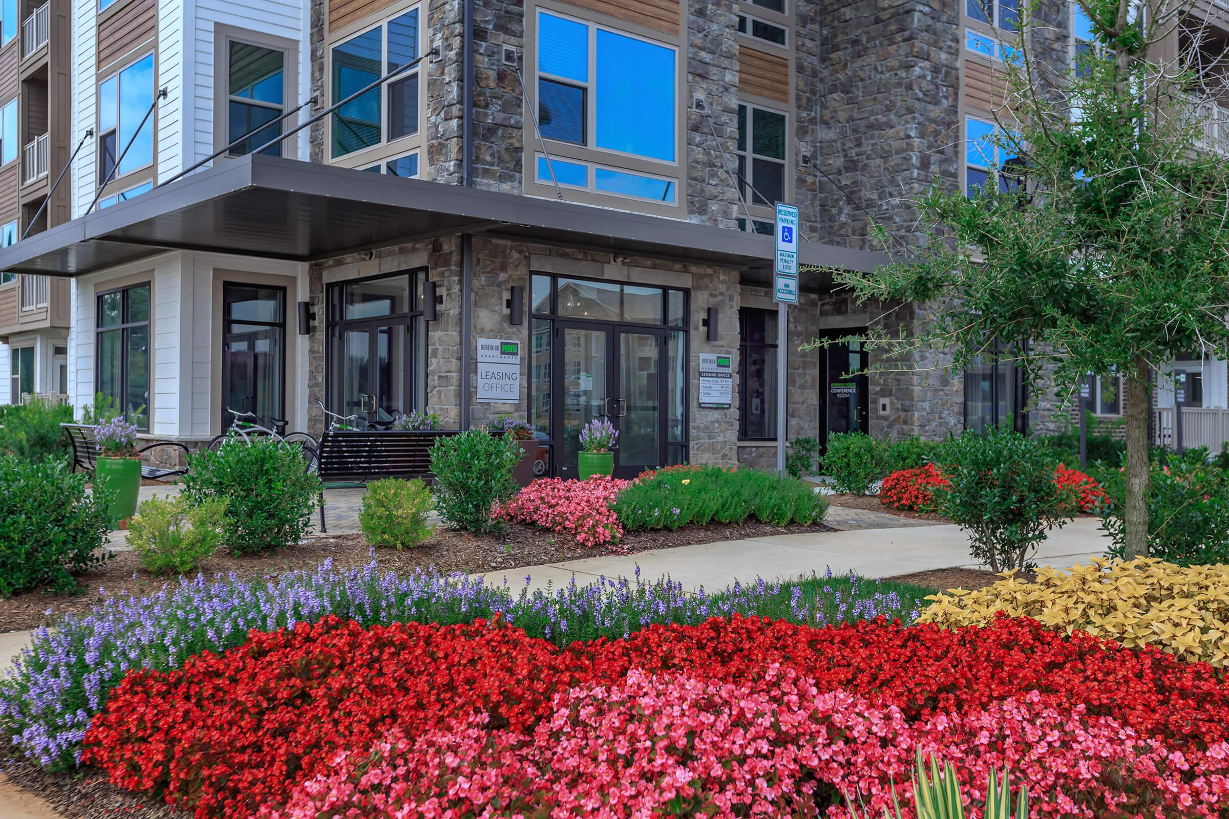 a colorful flower garden in front of Whitehern