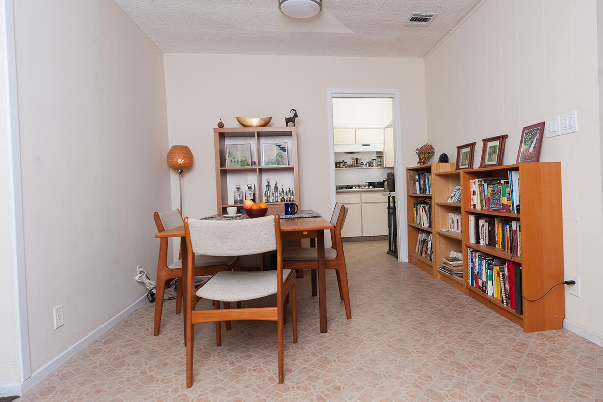 a living room filled with furniture and a book