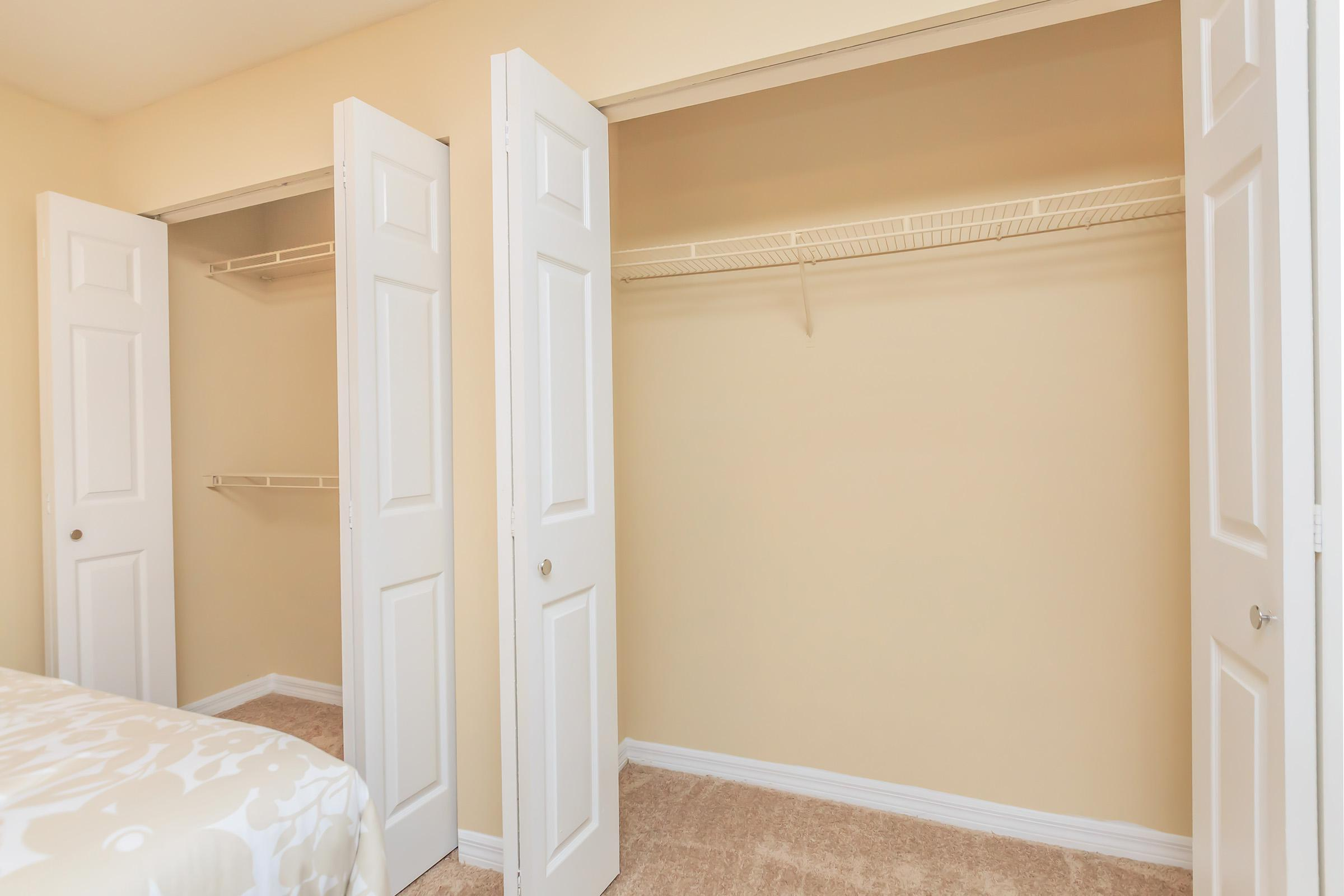 a bedroom with a bed a dresser and a door