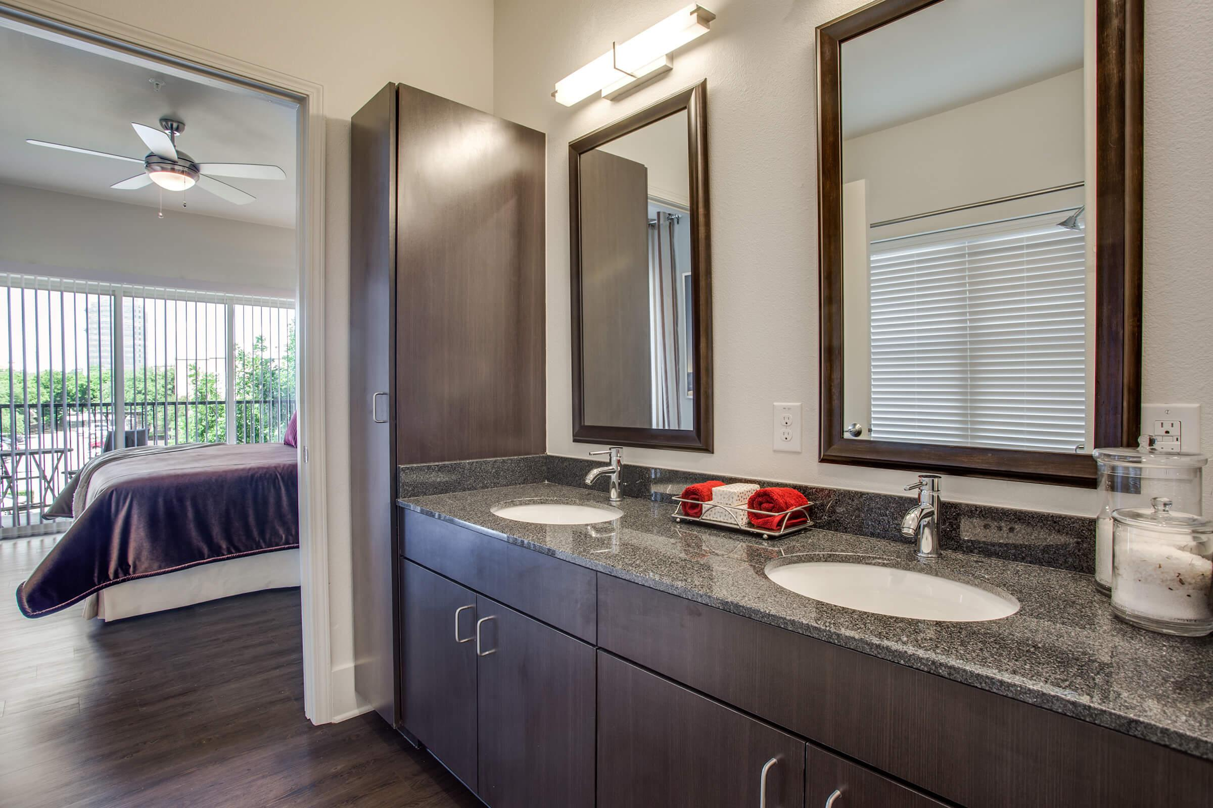 a kitchen with a sink mirror and window
