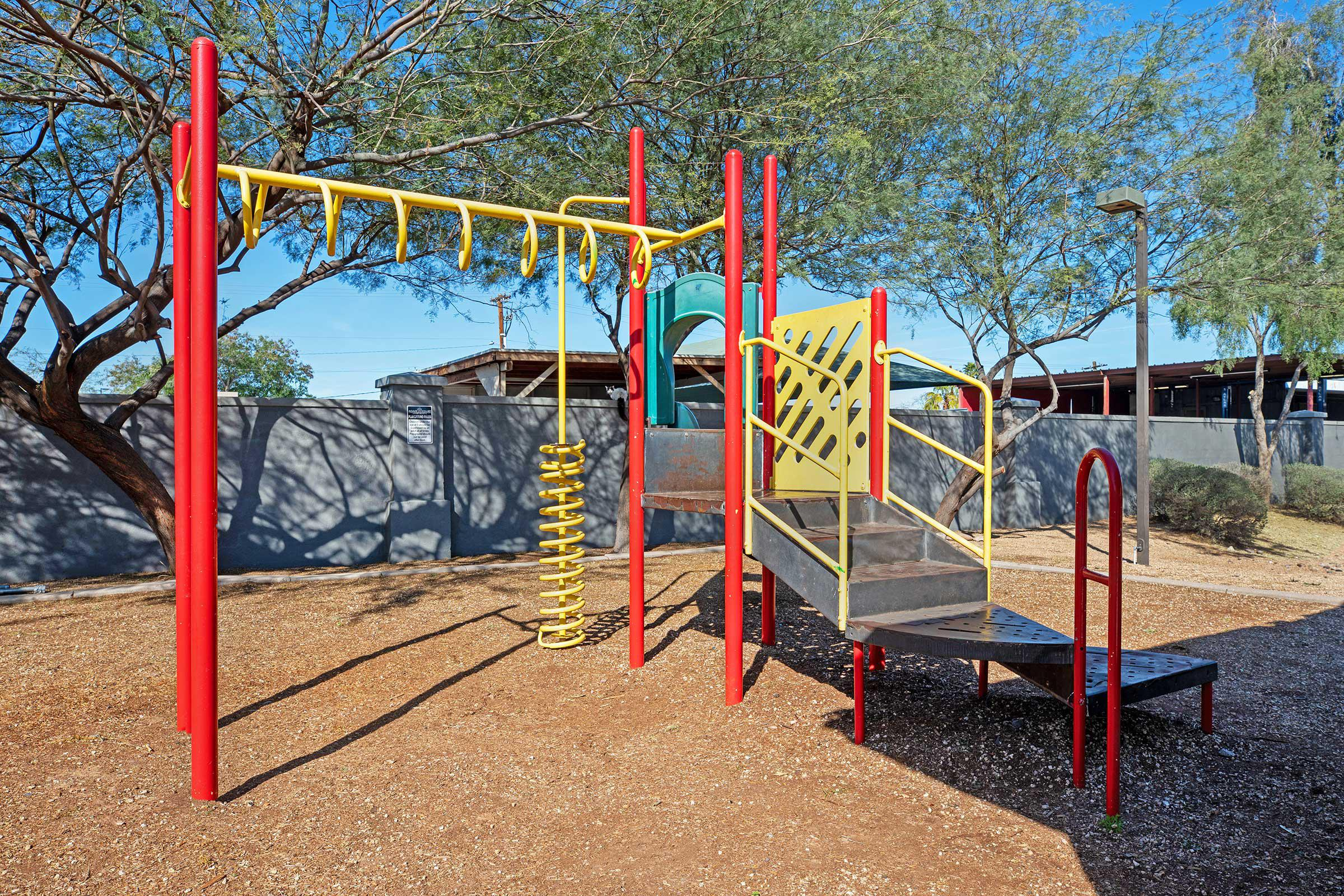 a playground inside a fence