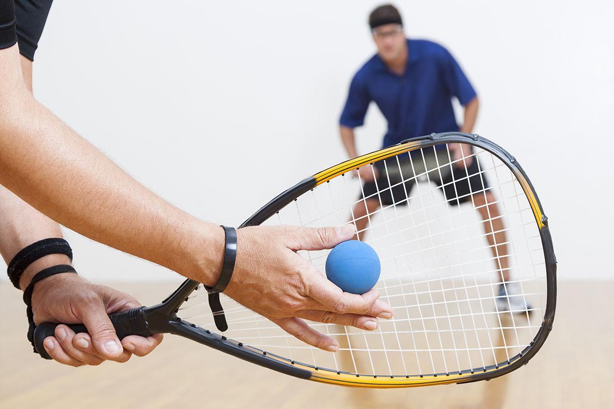 a man holding a racket