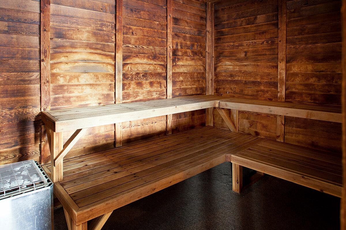 a wooden bench sitting next to a window