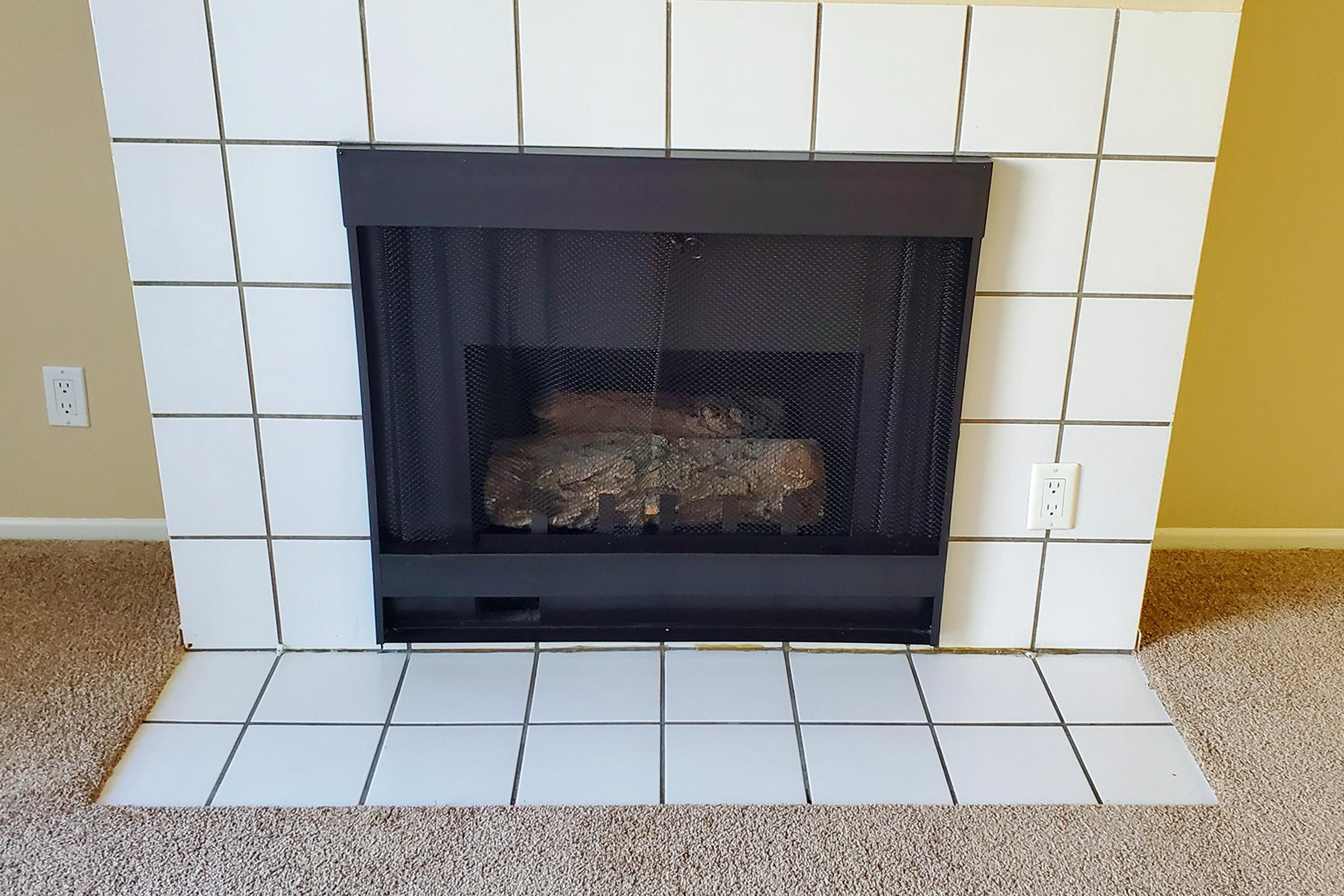 a stove top oven sitting next to a fireplace
