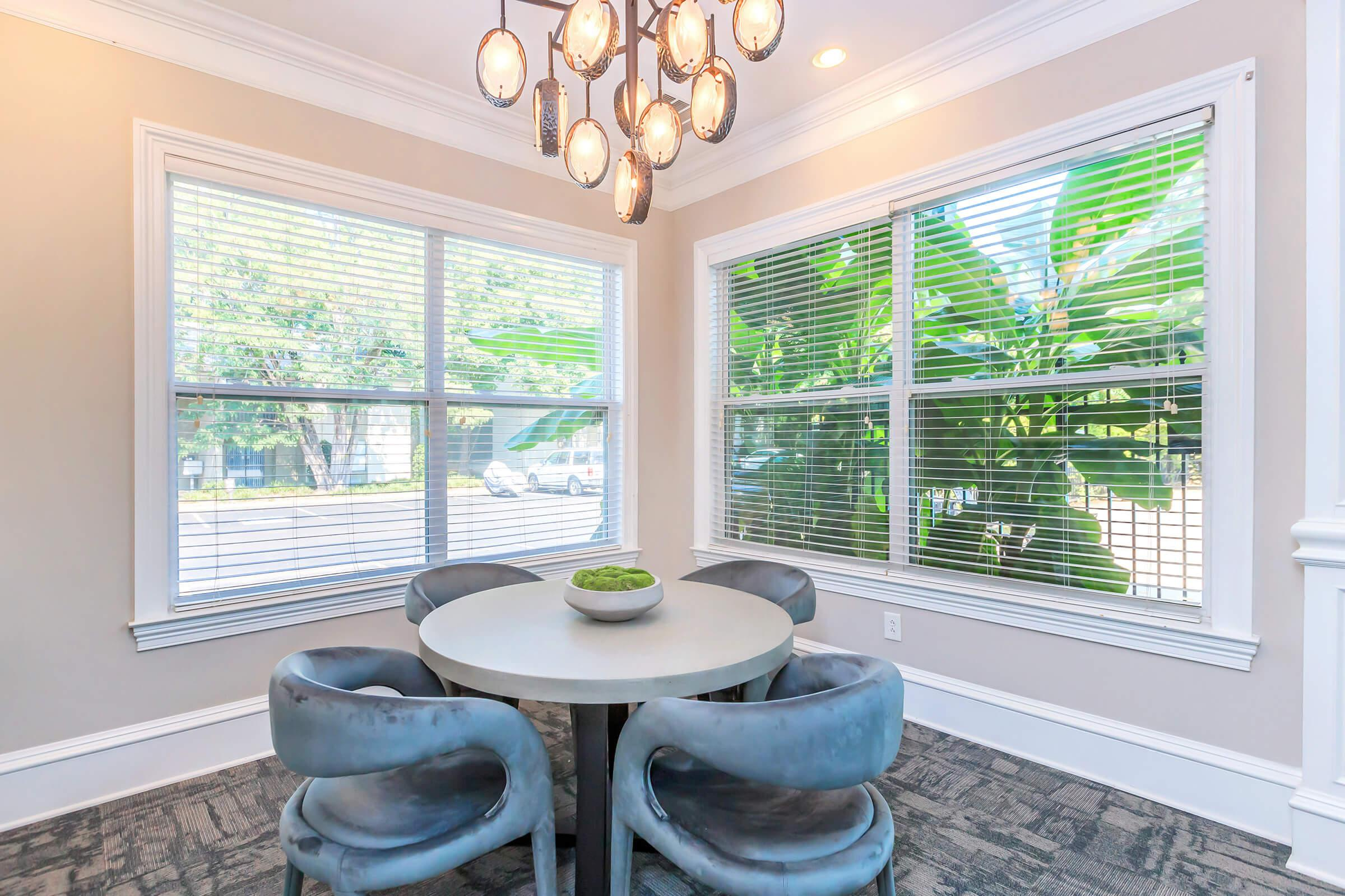 Another common area with a table-chairs in Ashwood
