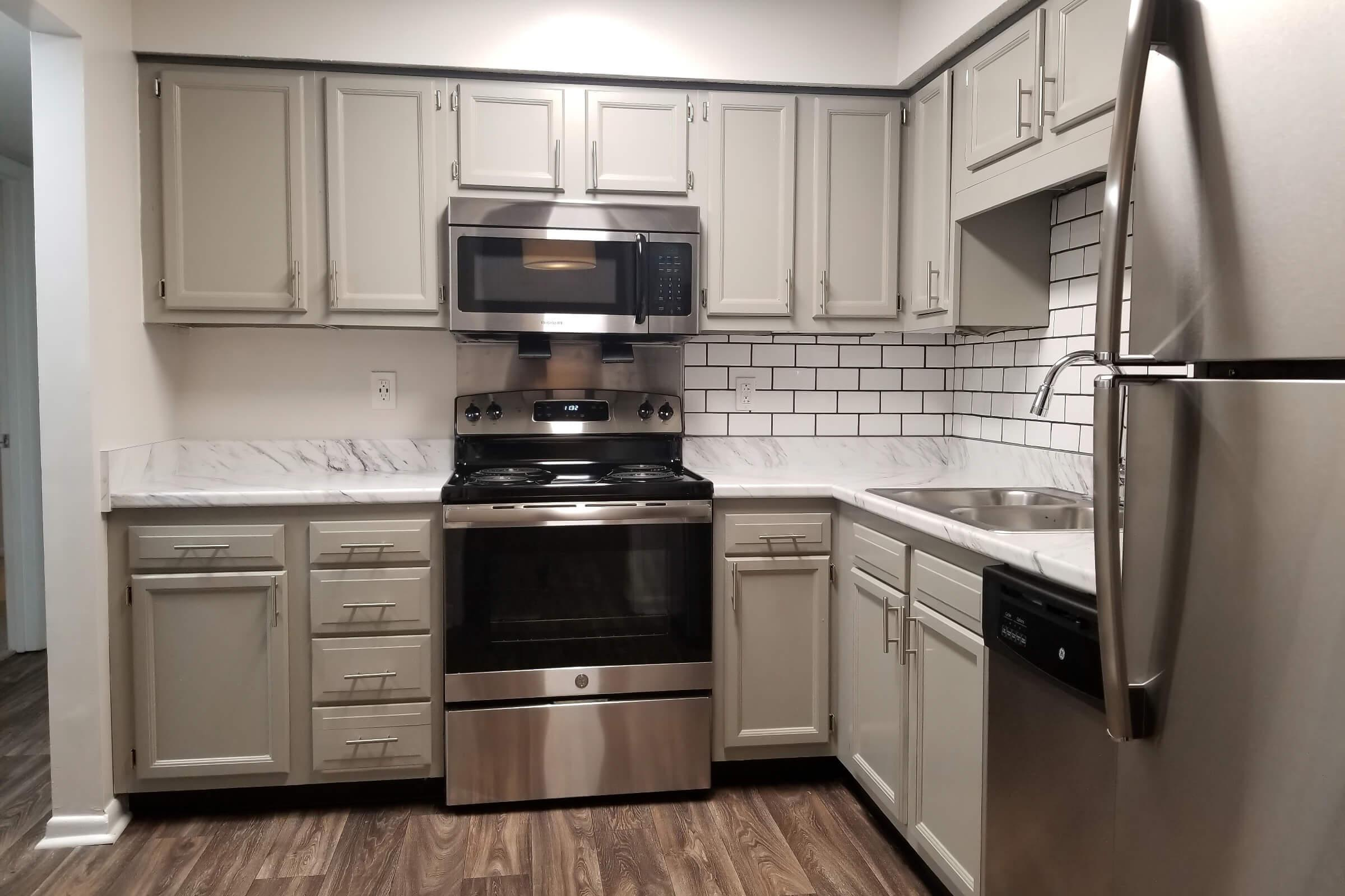 a kitchen with a stove and a refrigerator