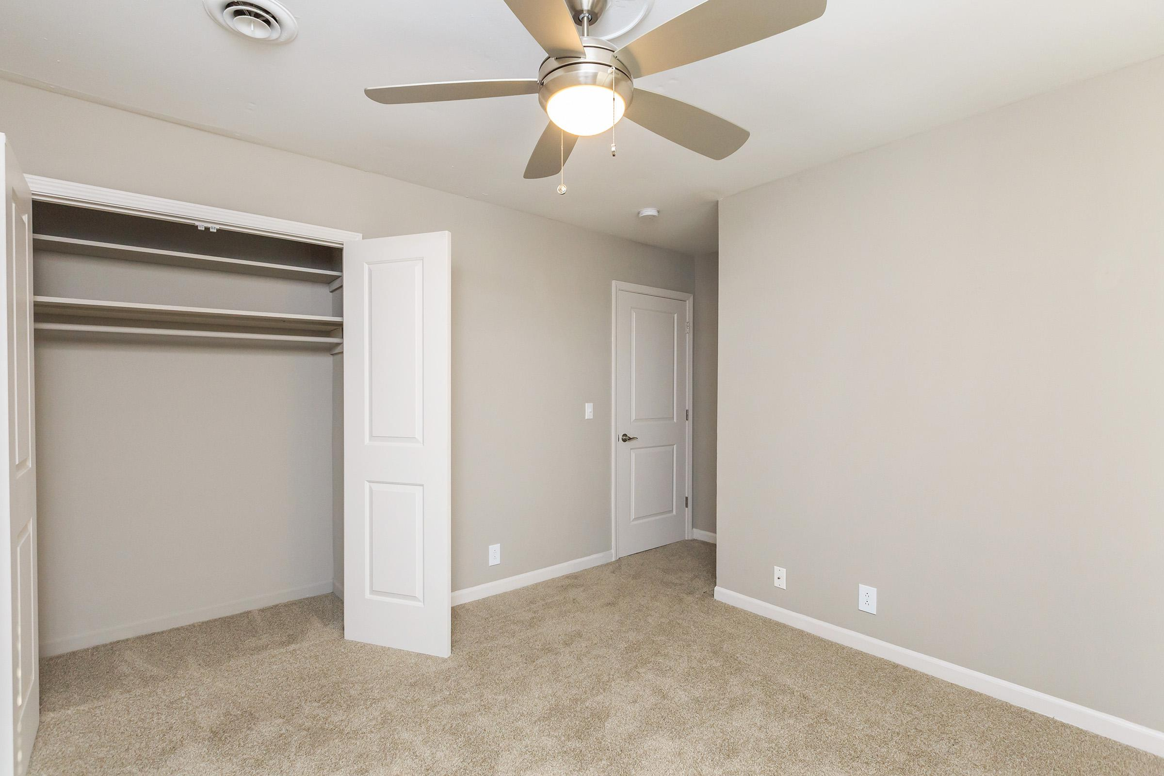 Bedroom with ceiling fan at Colony House in TN