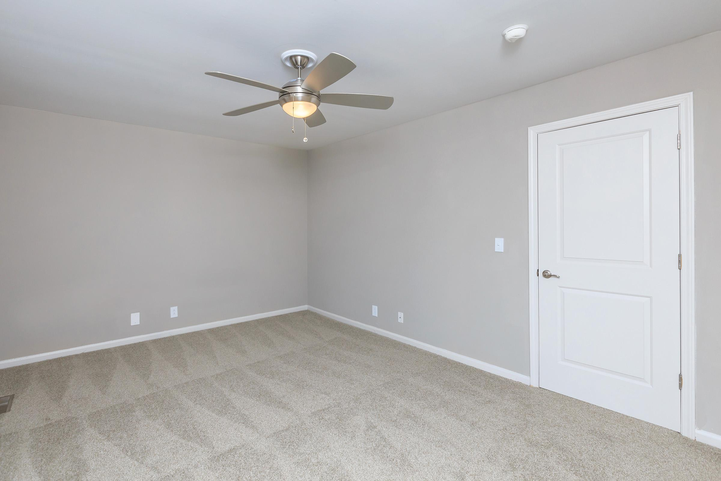 Spacious bedroom with ceiling fan at Colony House