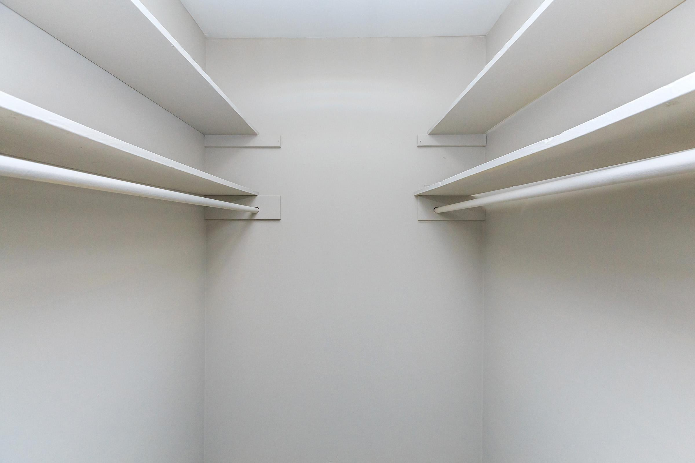 Walk-in closets at Colony House