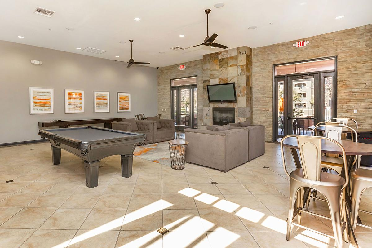 Enjoy a game of billiards in our community clubhouse at The Palladium Apartments in Las Vegas, Nevada