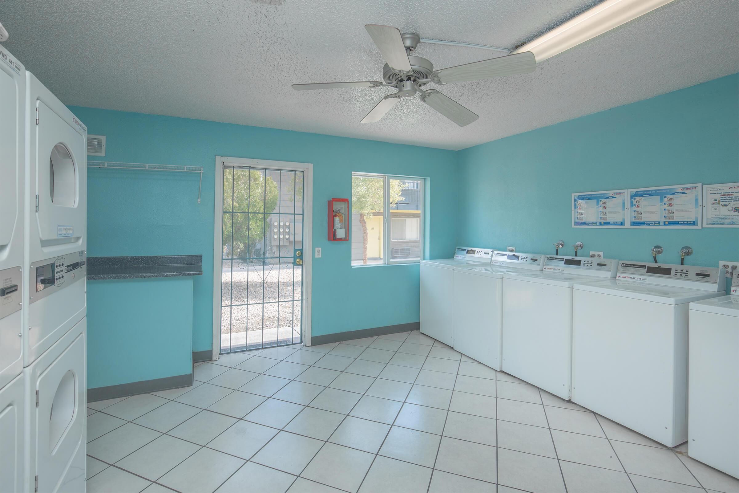 a kitchen with a blue and white tiled floor