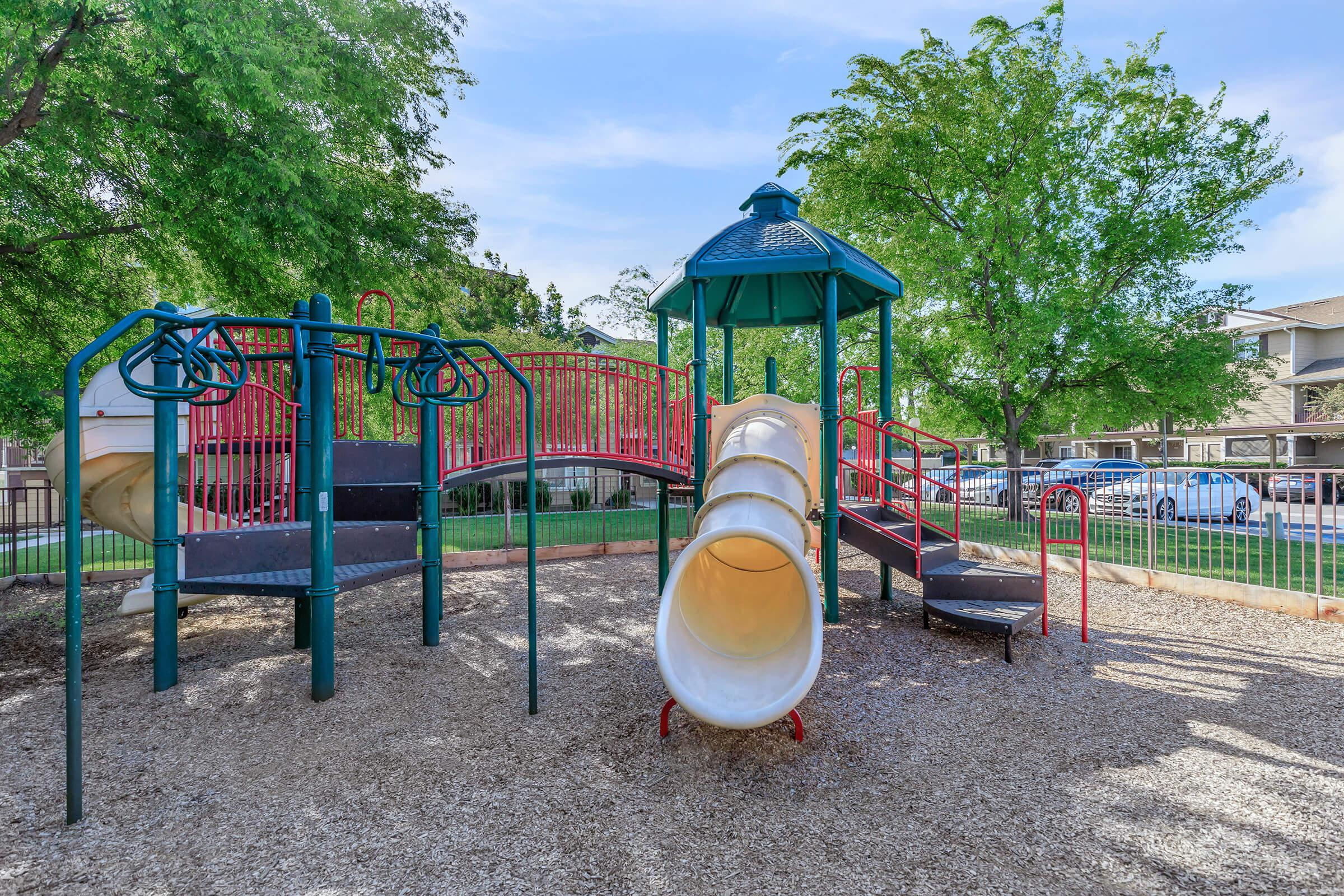 a playground in front of a fence